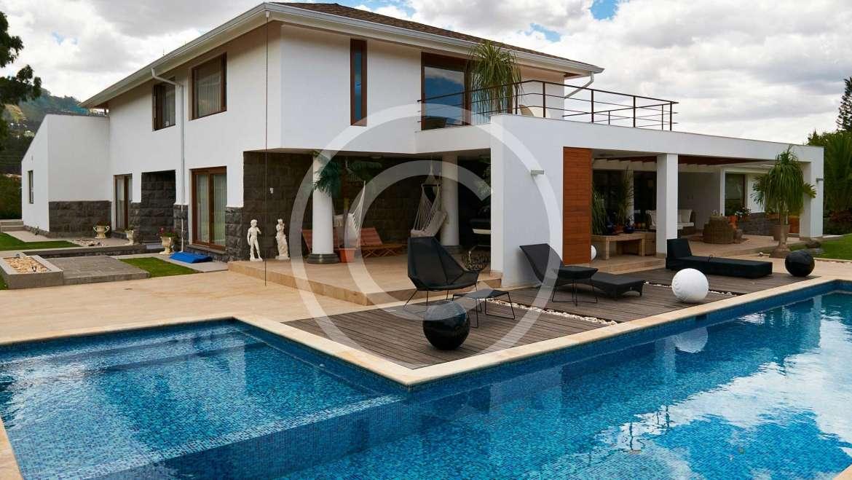 Geometric pool design using brick with gazebo & decorative lighting